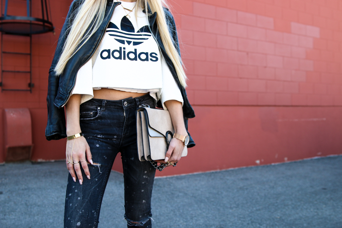 adidas-originals-cropped-sweater-zara-ripped-jeans-river-island-balenciaga-boots-fishnet-socks-12