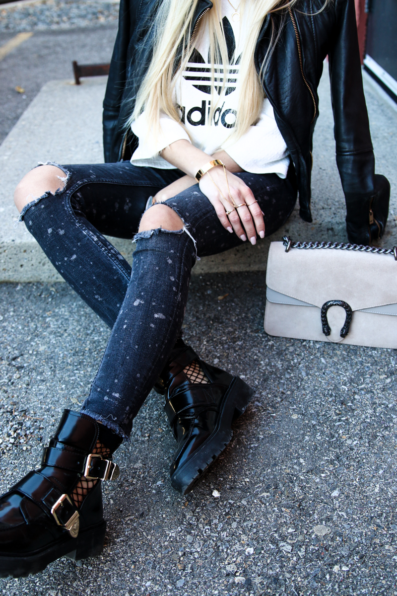 adidas-originals-cropped-sweater-zara-ripped-jeans-river-island-balenciaga-boots-fishnet-socks-13