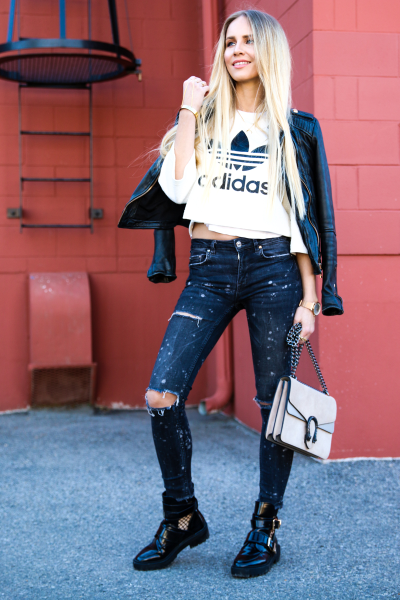 adidas-originals-cropped-sweater-zara-ripped-jeans-river-island-balenciaga-boots-fishnet-socks-3