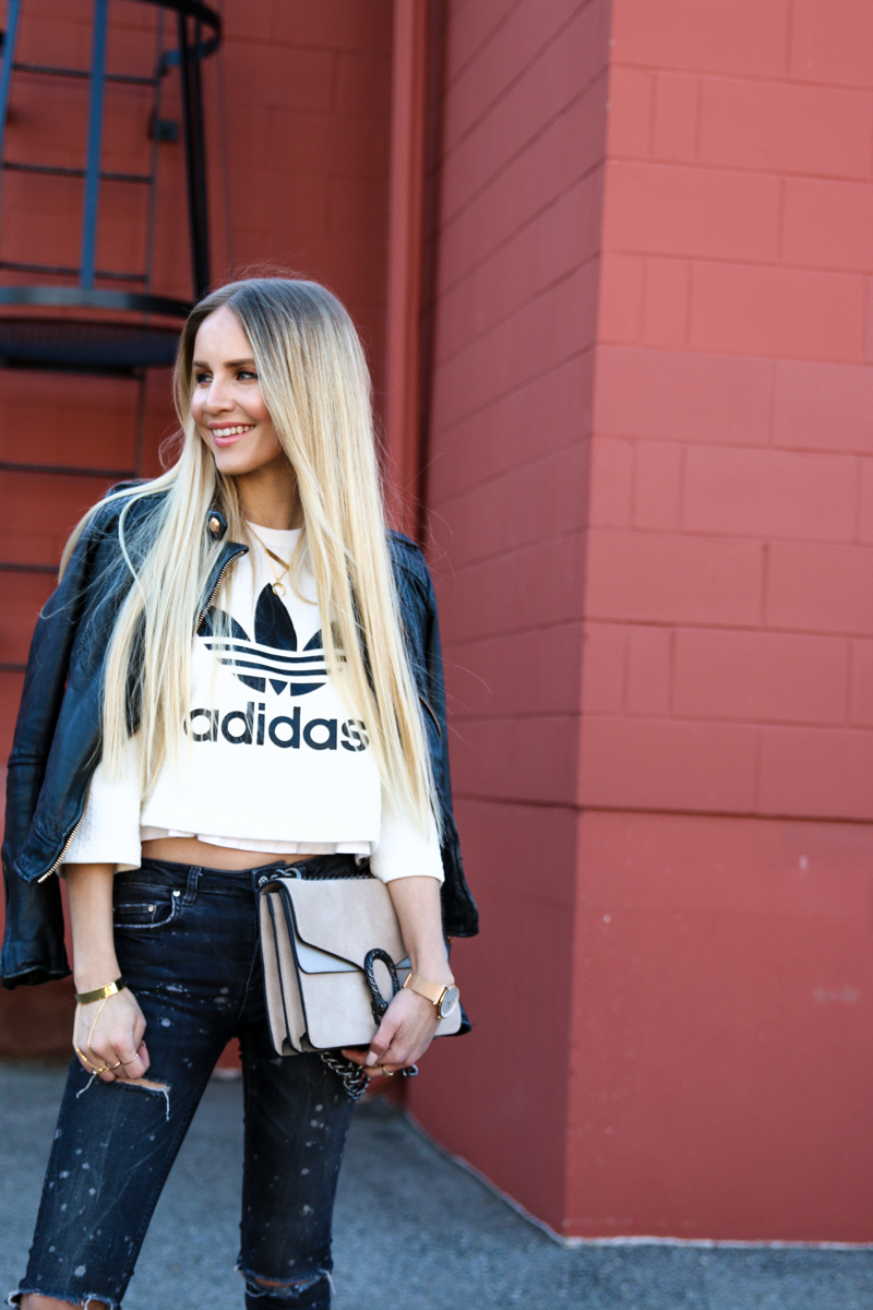 adidas-originals-cropped-sweater-zara-ripped-jeans-river-island-balenciaga-boots-fishnet-socks-9